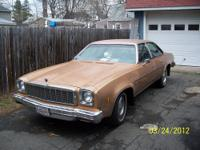 Chevelle Malibu Classic 4 door. Gold exterior. Black