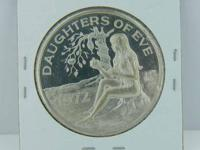 This is a 1975 Daughers of Eve Mardi Gras doubloon. On
