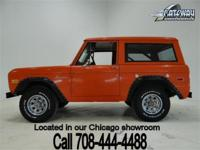 1975 Ford Bronco that is very solid. Orange paint and