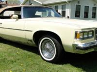 This Carmel Beige Grand Ville with Tan Convertible top