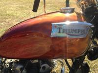 The item for sale is a 1975 Triumph Daytona 500 this