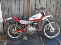 This bike has a 246cc 2 stroke engine with a 5 speed