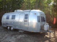 The pre-enjoyed 1976 Airstream Land Yacht Travel