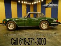 Great looking 1976 Triumph TR6. This numbers matching