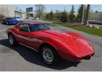 Attractive Red Corvette with the optional deluxe