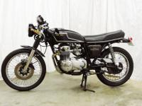 This is a pristine Honda CB Super Sport which has