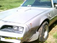 Silver 1977 Pontiac Trans Am with a 400 engine and 4