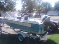 THIS IS A NICE BOAT WITH A 85 EVINRUDE. THIS IS A NICE