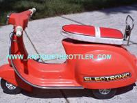 Toy Plastic Red Vespa P150x model. 3 wheels, 1 in