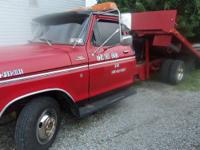 1978 Ford F350 Rollback Flatbed truck. It runs well and