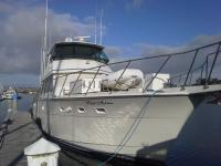 Enclosed, stabilized Hatteras yacht. Range 1000 NM.