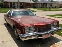 1978 Oldsmobile Toronado Brougham, red in color, very