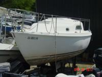 "Spaciuous 26' with 8'8"" beam. Outboard model. Head and"