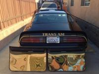 1978 T/A auto with t-tops, black/black matching #'s,