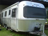THE CAMPER IS 8 1/2 M - 28 FT WITH BATHROOM ON SIDE. IT