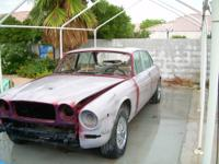 2 1979 Jaguar XJ12 Project Cars. One automobile has