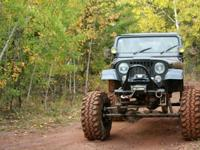 This awesome Rock Crawler features a Stroked I6 4.2