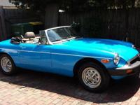 For sale is a classic British roadster - a 1979 MGB.