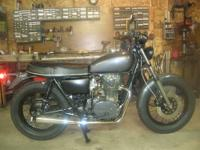 This is a custom built Yamaha 650 It began life as a