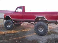 THIS IS A 1979 F-100 CHERRY RED CUSTOM 4 X 4 PICK-UP