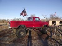 THIS IS A CHERRY RED 1979 F-100 CUSTOM 4X4 PICK-UP IT