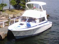 This Bertram 33 premium flybridge cruiser with a