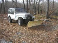 Plow Jeep has rusty frame and tub, plows well, runs