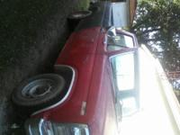 this is a 1980 ford truck. its red and black. it has a