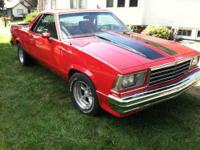 1980 Chevy El Camino. Red with black stripes. Arizona
