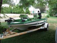 1980 Ranger 16 foot bass watercraft with trailer. Has