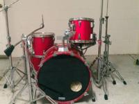 This is a red 1980's Tama Granstar drum set. It has