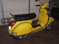 This is a clean 1980 Vespa Motor Scooter - Model 200E.