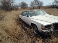 Selling 1980s Cadillac Deville Sedan. it ran when I