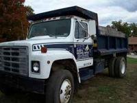 single axle, 12' dump bed . Calls only  Location:
