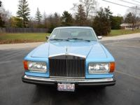 Exterior: Blue, 4 Door Sedan Interior: Blue Leather