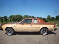 Body Style: Coupe Engine: Exterior Color: CINNAMON