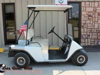 This metal body Ez-Go golf cart is in good condition.