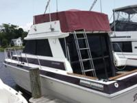 Twin 350 Mercruisers, repowered in 2003. Upper and