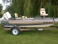 $1250 OBO  15' fiberglass body boat with 75HP Johnson