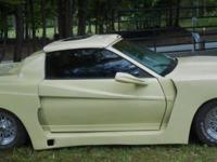 This is a 1983 Pontiac TransAm with a customized