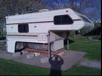 This is a 1983 Lance 11 Foot Cab-Over Camper. This