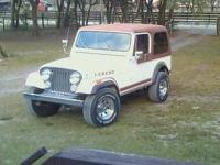 This is a factory original Jeep CJ7 Laredo with factory
