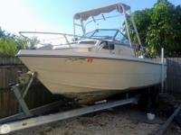 This classic Cobia has been repowered with a 2006