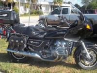 We have a 1984 Honda Goldwing 1200 in superb form, runs
