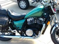 For sale is a very nice metallic green Honda by700