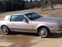 1984 Olds Tornado with half vinyl top, plush interior,