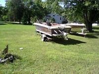 1984 brown Rinker boat and trailer for sale. 2.5 Liter