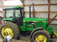 This John Deere 4450 Isa four wheel drive.It has 6100
