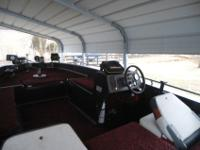 This is 1985 150hp with remote trolling motor, two new