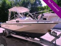 This timeless Boston Whaler 25 Revenge WA is fully